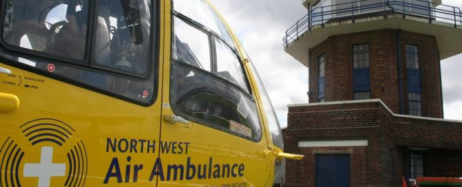 Image of air ambulance in front of a tower