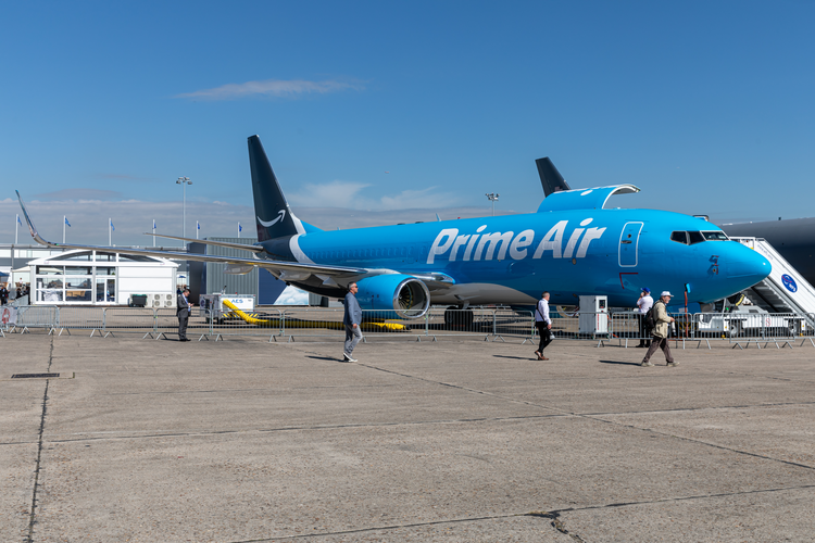 Image of parked Prime Air freight plane with crew