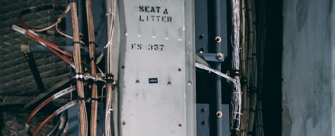 Picture of machinery labeled Seat A, and litter with wires around it.