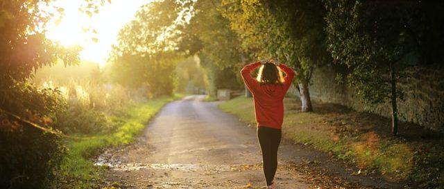 Image: woman walking outside on a path